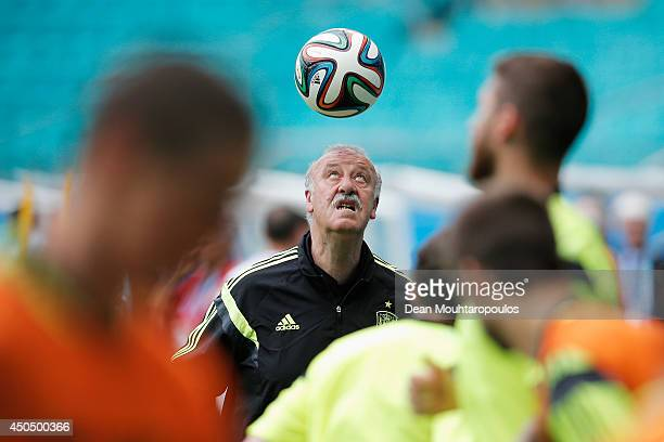 Spanish Head Coach Vicente del Bosque juggles the ball on his head as the players warm up during the Spain training session ahead of the 2014 FIFA...