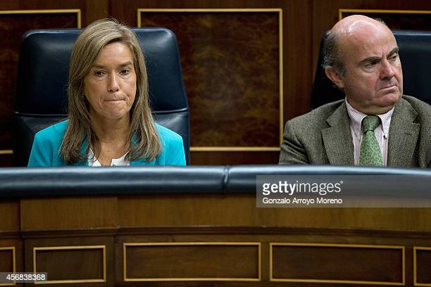 Spanish Health Minister Ana Mato and Spanish Minister of economy Luis de Guindos during a plenary session at the Spanish Parliament on October 8 2014...