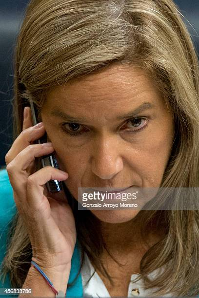 Spanish Health Minister Ana Mato answers a phone call during a plenary session at the Spanish Parliament on October 8 2014 in Madrid Spain Spanish...