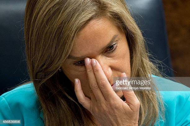 Spanish Health Minister Ana Mato touches her eyes prior to start a plenary session at the Spanish Parliament on October 8 2014 in Madrid Spain...