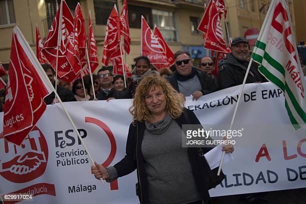 Spanish hotel maid Pepita Garcia Lupianez holds unions flags as she takes part in a protest against a reform of Spain's labour code in 2012 which...