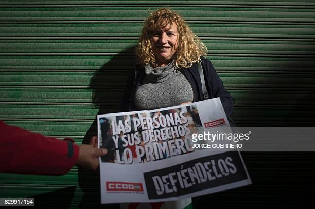 Spanish hotel maid Pepita Garcia Lupianez poses during a protest against a reform of Spain's labour code in 2012 which maids say has led to lower...