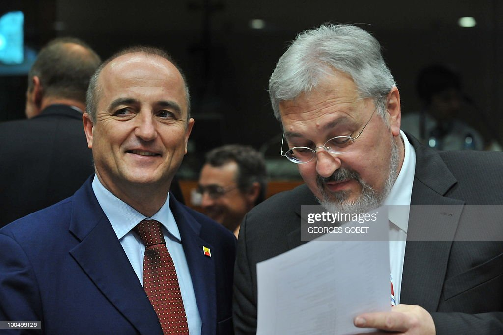 Spanish Industry, Tourism and Trade Minister Miguel Sebastien (L) stands next to an advisor on May 25, 2010 before the start of a Competitiveness Council meeting at EU headquarters in Brussels.