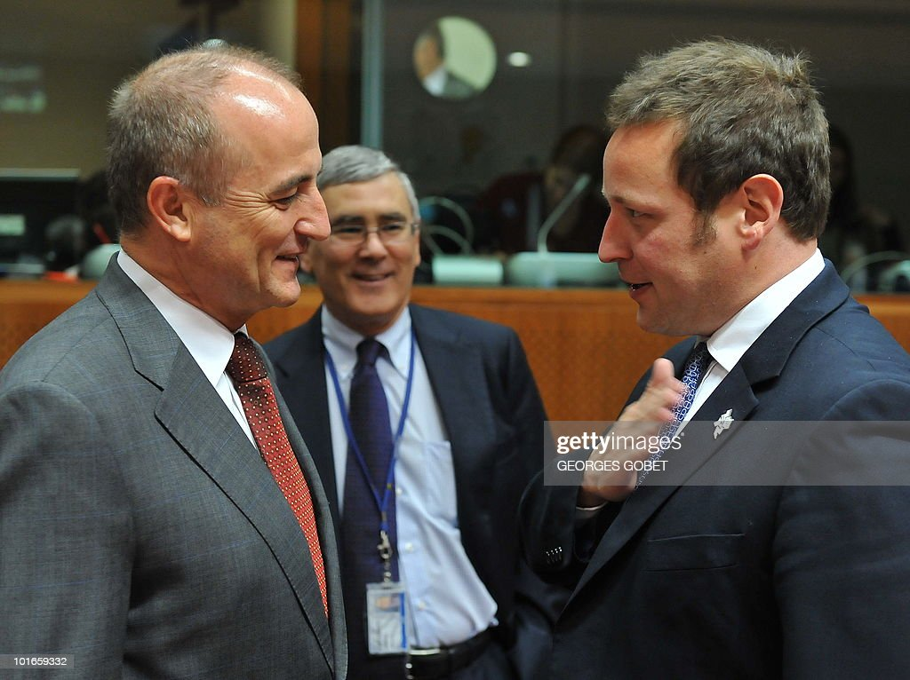 Spanish Industry, Trade and Tourism Minister Miguel Sebastian Gascon (L) and new British Culture, Communications and Creative Industries Secretary Ed Vaizey (R) chat on May 31, 2010 before a Telecommunications Council meeting at EU headquarters in Brussels.