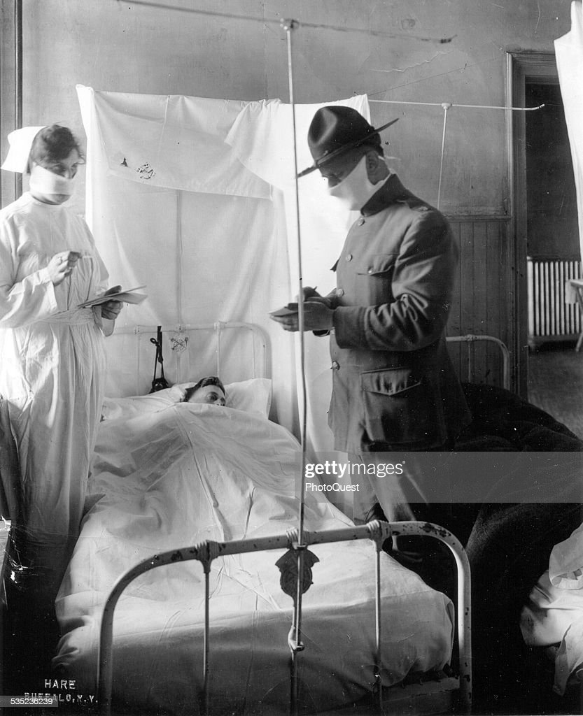 Spanish Influenza in Army Hospitals Masks and cubicles used in USA General Hospital No 4 Fort Porter New York 1918 Patients' beds are reversed...