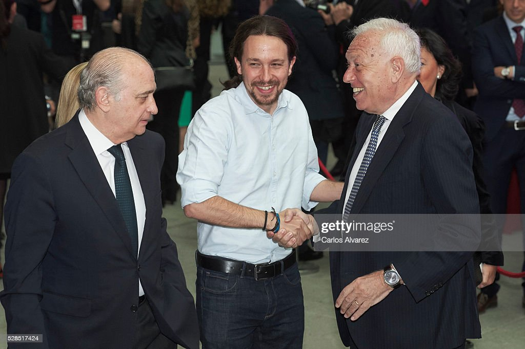 Spanish Interior Minister Jorge Fernandez Diaz (L), leader of party Podemos Pablo Iglesias (C) and Spanish Foreign Minister Jose Manuel Garcia Margallo (R) attend 'Ortega Y Gasset' journalism awards 2016 at Palacio de Cibeles on May 05, 2016 in Madrid, .