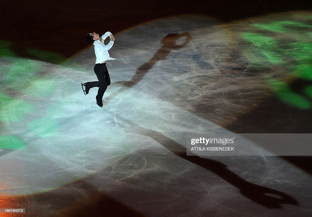 Spanish Javier Fernandez performs in the 'Dom Sportova' sports hall in Zagreb on January 27, 2013 during the gala of the ISU European Figure Skating Championships. AFP PHOTO / ATTILA KISBENEDEK
