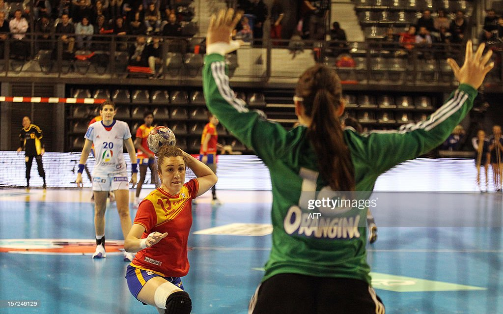 Spanish Jessica Alonsa takes a penalty shot during her friendly handball match between France and Spain, on November 30, 2012 at the Palais des victoires sports hall, in Cannes, south-eastern France. AFP PHOTO / JEAN CHRISTOPHE MAGNENET