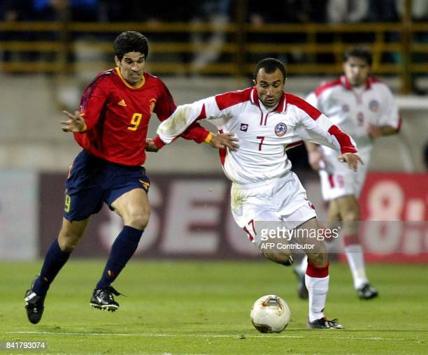 Spanish Juan Carlos Valeron fights for the ball with Petrosyan of Armenia during their Euro 2004 qualifying group 6 match in Jose Amilivia stadium of...