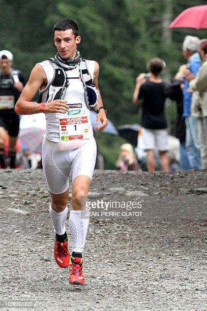 Spanish Kilian Jornet competes during the 8th Edition of the North Face UltraTrail considered as one of the hardest countryside trail races on August...