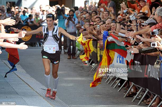 Spanish Kilian Jornet reacts as finishing first the 7th Edition of the North Face UltraTrail considered as one of the hardest countryside trail races...