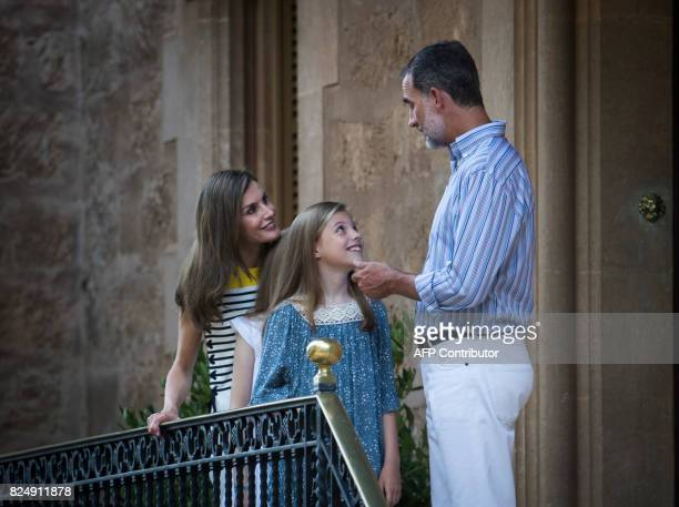 Spanish King Felipe VI and Queen Letizia pose with their daughter Spanish crown princess Sofia in the gardens at the Marivent Palace on the island of...