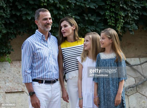 Spanish King Felipe VI and Queen Letizia pose with their daughters Spanish crown princess Leonor and princess Sofia in the gardens at the Marivent...
