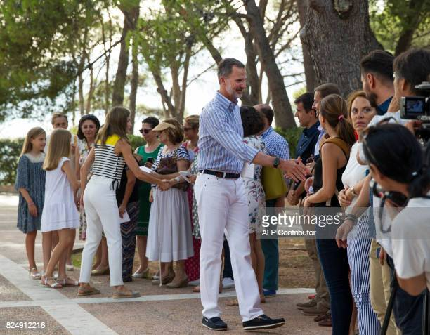Spanish King Felipe VI and Queen Letizia shake hands with the journalists followed by their daughters Spanish crown princess Leonor and princess...
