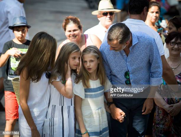 Spanish King Felipe VI and Queen Letizia speak with their daughters Spanish crown princess Leonor and princess Sofia during their visit to the...