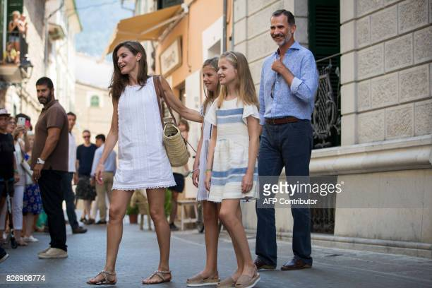 Spanish King Felipe VI his wife Queen Letizia and their daughters Spanish crown princess Leonor and princess Sofia smile to people during their visit...