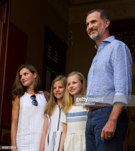 Spanish King Felipe VI his wife Queen Letizia and their daughters Spanish crown princess Leonor and princess Sofia pose at the door of Can Prunera...