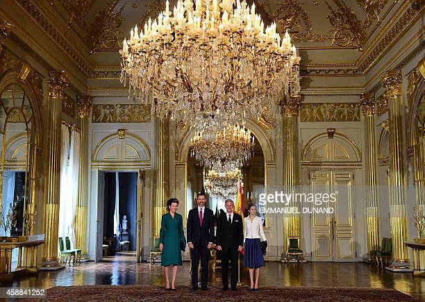 Spanish King Felipe VI his wife Queen Letizia Belgiums King Philippe and his wife Queen Mathilde pose for a picture during a visit at the Royal...