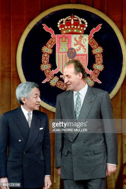 Spanish King Juan Carlos and Japanese Emperor Akihito watch a parade of the Royal Guard at the Pardo Palace in Madrid on October 10 1994 The imperial...