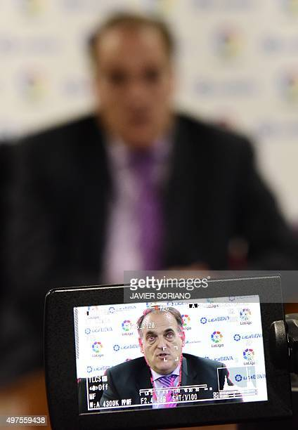 Spanish League Football President President Javier Tebas is seen on a video monitor as he speaks during an interview with AFP in Madrid on November...