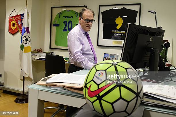 Spanish League Football President President Javier Tebas poses in his office after a interview with AFP in Madrid on November 17 2015 The head of the...