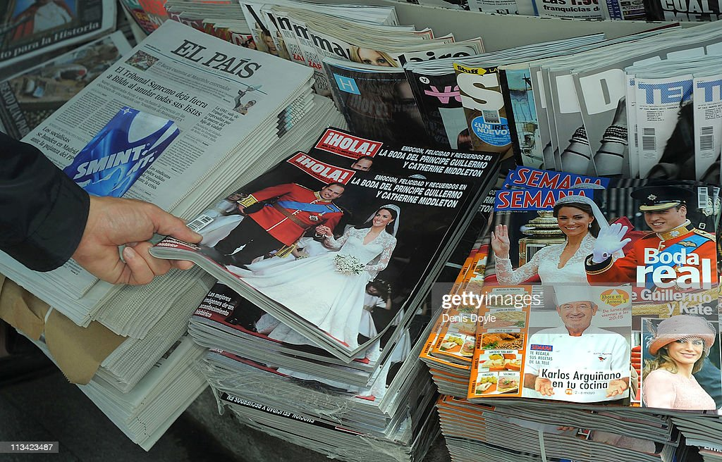 Spanish magazines show photographs of their Royal Highnesses Prince William, Duke of Cambridge and <a gi-track='captionPersonalityLinkClicked' href=/galleries/search?phrase=Catherine+-+Duchess+of+Cambridge&family=editorial&specificpeople=542588 ng-click='$event.stopPropagation()'>Catherine</a>, Duchess of Cambridge following their wedding, at a newsstand on May 2, 2011 in Madrid, Spain. The marriage of the second in line to the British throne was led by the Archbishop of Canterbury and was attended by 1900 guests, including foreign Royal family members and heads of state. Thousands of well-wishers from around the world flocked to London to witness the spectacle and pageantry of the Royal Wedding.