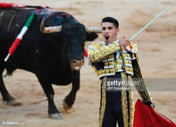 Spanish matador Alejandro Talavante brandishes a sword as he fights a Nunez del Cuvillo's fighting bull during the seventh bullfight of the San...