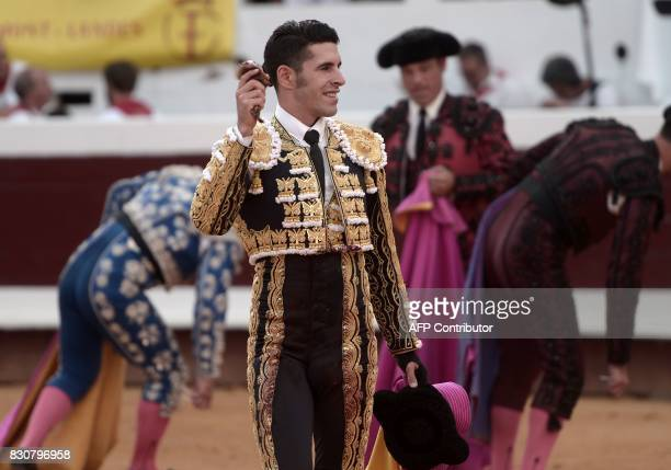 Spanish matador Alejandro Talavante holds the ear of a Domingo Hernandez Martin bull at The Dax Arena during the festival of Fetes de Dax...