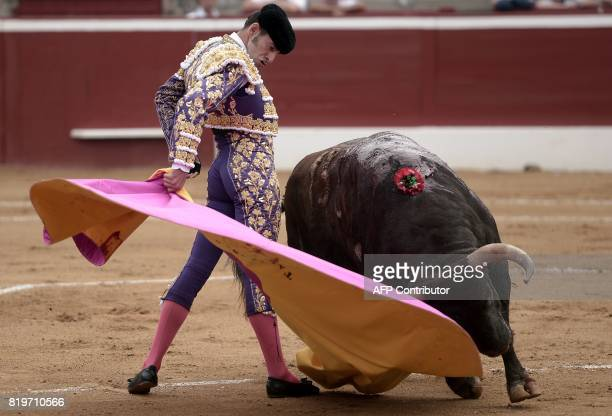 Spanish matador Alejandro Talavante performs a pass on a Nunez Del Cuvillo bull at Plumacon arena in Mont de Marsan during the festival of La...