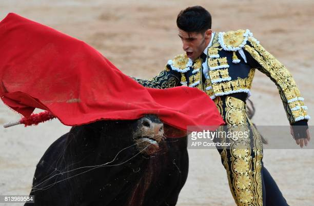 Spanish matador Alejandro Talavante performs a pass to a Nunez del Cuvillo's fighting bull during the seventh bullfight of the San Fermin Festival in...