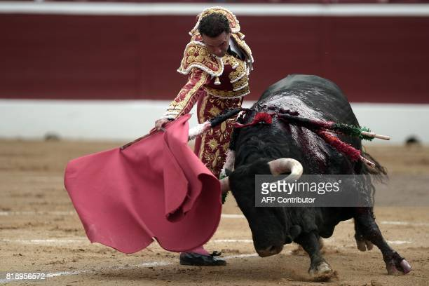 TOPSHOT Spanish matador Antonio Ferrera fights a Juan Pedro Domecq bull at the Plumacon Arena in MontdeMarsan during the Festival of La Madeleine in...