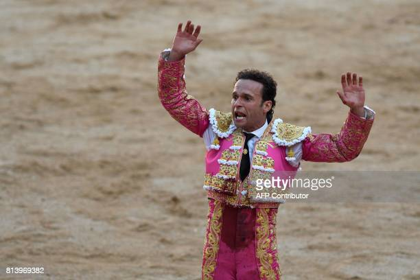 Spanish matador Antonio Ferrera gestures after stabing with a sword a Nunez del Cuvillo's fighting bull during the seventh bullfight of the San...
