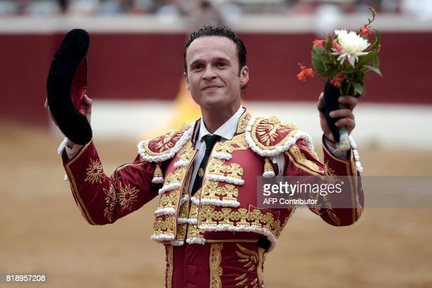 Spanish matador Antonio Ferrera holds the ear of a bull as he acknowledges spectators after fighting a Juan Pedro Domecq bull at the Plumacon Arena...