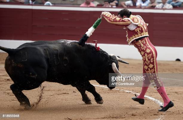 Spanish matador Antonio Ferrera inserts a banderilla stick on a Juan Pedro Domecq bull at the Plumacon Arena in MontdeMarsan during the Festival of...