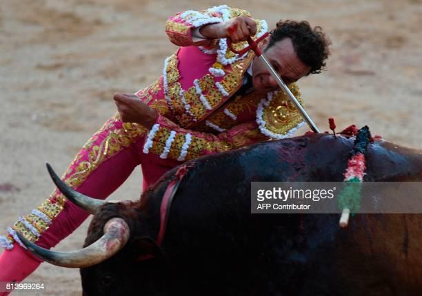 Spanish matador Antonio Ferrera stabs with a sword a Nunez del Cuvillo's fighting bull during the seventh bullfight of the San Fermin Festival in...