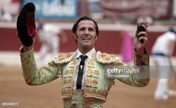 Spanish matador David Mora holds the ear of a La Quinta bull at Plumacon arena in MontdeMarsan southwestern France during the festival of La...