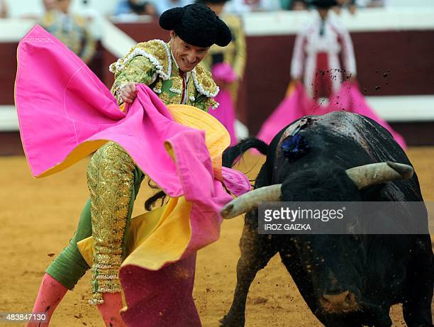 Spanish matador Diego Urdiales performs a pass on a Jandilla bull during the festival of Dax southwestern France on August 132015 AFP PHOTO / GAIZKA...