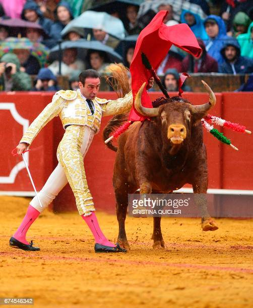 Spanish matador Enrique Ponce performs a pass with muleta on a bull during a bullfight at the Maestranza bullring in Sevilla on April 28 2017 / AFP...