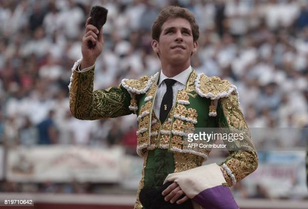 Spanish matador Gines Marin holds the ear of a Nunez Del Cuvillo bull at Plumacon arena in Mont de Marsan during the festival of La Madeleine...