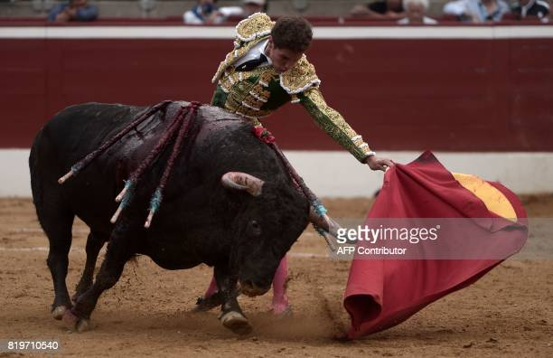Spanish matador Gines Marin performs a pass on a Nunez Del Cuvillo bull at Plumacon arena in Mont de Marsan during the festival of La Madeleine...