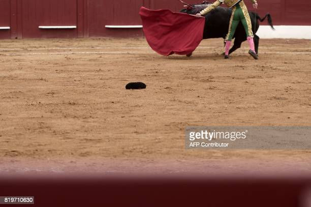 Spanish matador Gines Marin performs a pass on a Nunez Del Cuvillo bull at Plumacon arena in Mont de Marsan during the festival of La...