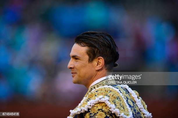 Spanish matador Jose Maria Manzanares walks around the bullring as he acknowledges the public during a bullfight at the Maestranza bullring in...