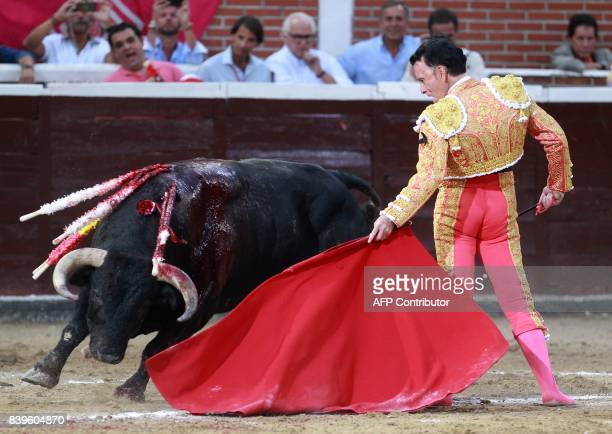 Spanish matador Jose Ortega Cano performs a pass on a bull during the Feria de Remedios bullfight festival at La Tercera bullring in San Sebastian de...