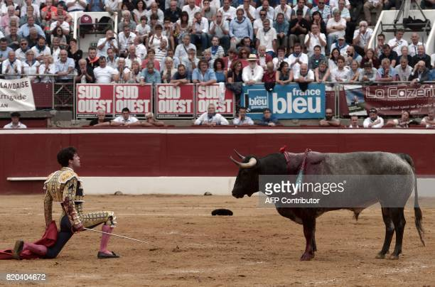 TOPSHOT Spanish matador Juan Del Alamo stands in front of a La Quinta bull at Plumacon arena in MontdeMarsan southwestern France during the festival...