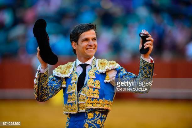 Spanish matador Julian Lopez 'El Juli' acknowledges the public showing the bull's ear during a bullfight at the Maestranza bullring in Sevilla on...
