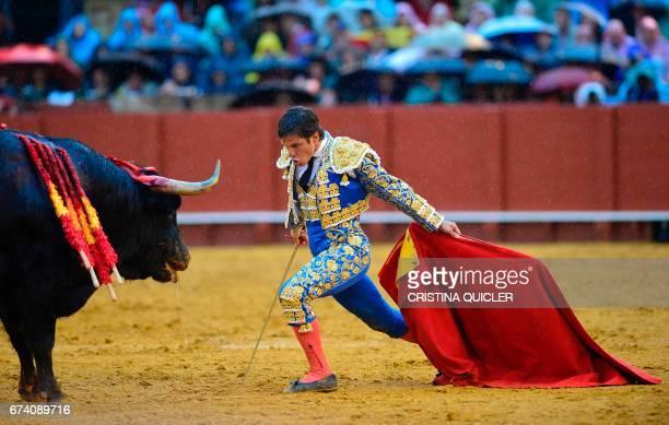 Spanish matador Julian Lopez 'El Juli' looks at the bull during a bullfight at the Maestranza bullring in Sevilla on April 27 2017 / AFP PHOTO /...