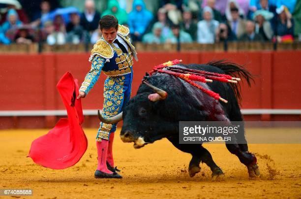 Spanish matador Julian Lopez 'El Juli' performs a pass with muleta on a bull during a bullfight at the Maestranza bullring in Sevilla on April 27...