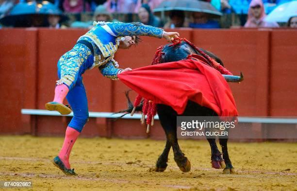 Spanish matador Julian Lopez 'El Juli' stabs the bull with the sword during a bullfight at the Maestranza bullring in Sevilla on April 27 2017 / AFP...