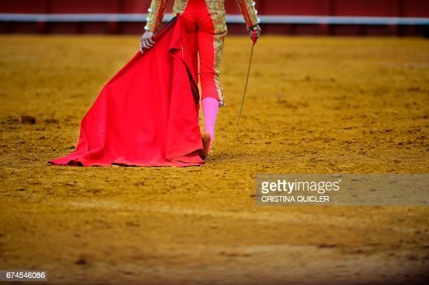 TOPSHOT Spanish matador Lopez Simon walks barefoot on the bullring during a bullfight at the Maestranza bullring in Sevilla on April 28 2017 / AFP...