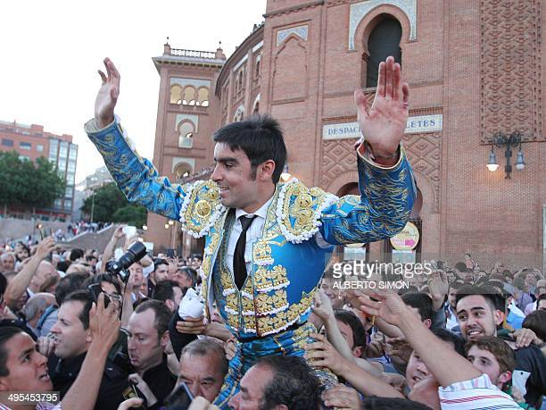 Spanish matador Miguel Angel Perera salutes supporters after the San Isidro Feria at the Las Ventas bullring in Madrid on June 3 2014 AFP PHOTO /...
